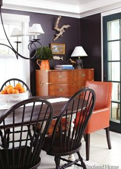 Love the dark walls paired with white accents and rich oranges