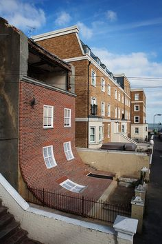 "From the Knees of My Nose to the Belly of My Toes"" A Surreal Display by British Designer Alex Chinneck    English Building's Brick Facade Playfully Slumps Down - My Modern Metropolis"