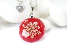 Christmas Gift for Mom, Red Pendant Necklace, Resin Necklace, Necklace with Real Flower, Gift for Her, Round Pendant Necklace, Holiday gift.  This is real flower necklace and represents beauty of nature. The process of making this piece is done entirely by hand. It starts with hand picking some interesting flower, then embedded this small part of nature into crystal clear resin. I created this necklace using white Queen annes lace flower and red resin. Pendant is faceted and because of that…