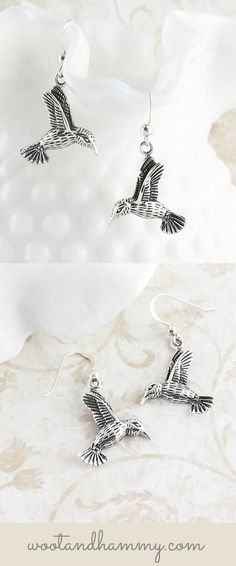 Hummingbird dangle earrings in sterling silver.