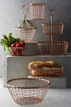 These copper wire storage baskets are definitely so 'on trend' and would be a great modern feature in a farmhouse kitchen Wire Basket Storage, Wire Storage, Wire Baskets, Bread Baskets, Kitchen Redo, Kitchen Items, Floors Kitchen, Boho Kitchen, Kitchen Products