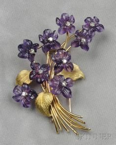 18kt Gold, Carved Amethyst, and Diamond Brooch, France, depicting a spray of violets with carved amethyst petals, diamond melee centers, lg. 3 in., maker's mark and guarantee stamps.  Skinner