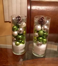 Put Epsom Salt in the bottom of 2 Dollar Tree cylinder vases. Add you choice of pine cones and small ornaments. Cheap and easy Christmas decor.