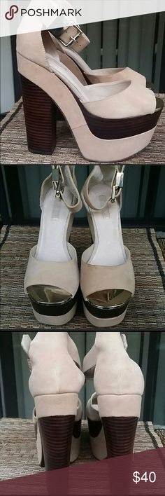 Absolutely stunning Topshop London platforms. Stunning tan and brown gold toe and buckle. 2 1/2 inch wood platform with 6 inch heel. There is a tiny smudge (as shown in photos, unnoticeable when worn. Topshop size 4, equivalent to US size 6.5. Topshop Shoes Platforms