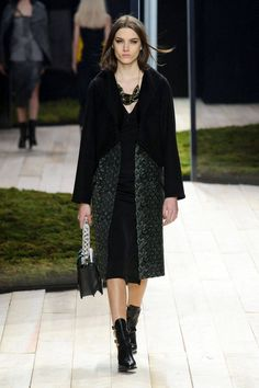 Their coats were especially great, splicing two fabrics in a way that created natural curves, even on the straightest of coats or vests.    - HarpersBAZAAR.com