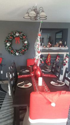 Santa hat decorations on chairs in formal dinning room