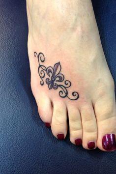 Fleur de lis tattoo!!!! I like the idea of it on your foot.