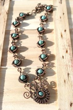 Wire work necklace with stabilized turquoise beads