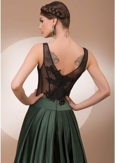 Satin, tulle and lace evening dress A-line silhouette with hand embellished top Back closes with zipper Color: black top and dark green skirt