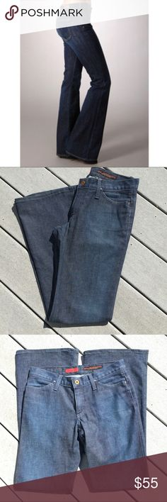 """AG """"Legend"""" Flare Leg Jeans Adriano Goldschmied, Excellent condition. Dark wash jeans with Flare leg design. Zipper fly with slide button closure and 5 pocket styling. 97% cotton, 3% lycra. Made in USA. When flat, waist measures about 14.5"""" across; front Rise about 8"""" and inseam about 32"""". Very mild natural distressing noted on back pockets and mild discoloration noted on inside (interior part) of bottom of jeans. Ag Adriano Goldschmied Jeans Flare & Wide Leg"""