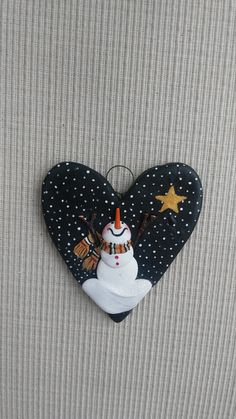hand sculpted polymer clay Shining star snowman ornament by JessiesCornerClay on…