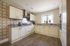 A cream coloured shaker style kitchen design with great storage space. Modern Kitchen Cabinets, Kitchen Cabinet Design, Long Melford, Shaker Style Kitchens, New Homes For Sale, Storage Spaces, Interiors, Cream, Home Decor