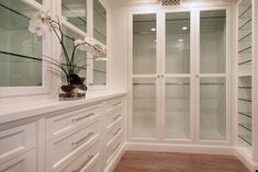 Patterson Construction-love all the glass shelves, and hardware