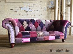 Modern British and handmade bold purple Patchwork Chesterfield Sofa. Totally unique fabric 3 seater, shown in a range of purple hue colours. | Abode Sofas