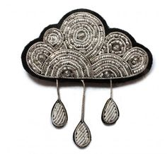 Silver embroidered cloud brooch, by Macon & Lesquoy.