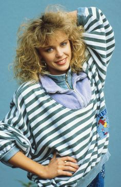 1980s Kylie Minogue. I desperately wanted my hair to look like Kylies and let my mum 'home perm' it many times. It never quite worked out