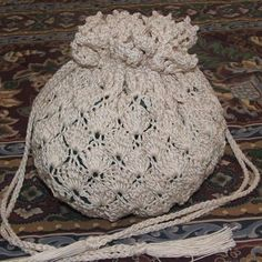 Dressy drawstring bag:  Easily worked using double strands of size 10 cotton crochet thread for duability and best of all, requires no liner.