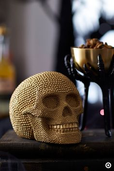 To give your home a glam and ghostly look, give a spooky gold skull a try this Halloween. Featuring a mischievous grin and covered in gold gems, it's the perfect addition to any room in your home.