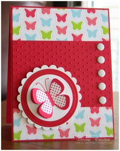 handmade card ... red with bright butterfly print paper ... cute butterfly on layered circles ... good layout ... pretty card!!