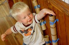 A pom pom drop activity for toddlers--an interesting thing for preschool classrooms as well
