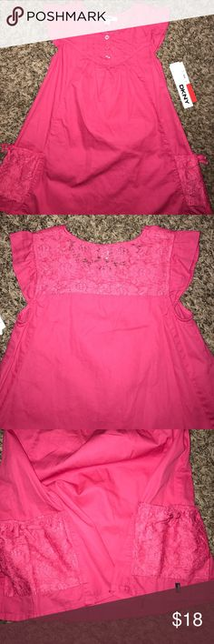 NWT girls DKNY dress NWT! Never worn super cute girls DKNY dress. Material is like a denim. 3 front bottoms and 2 side pockets. Perfect dress for Spring or Summer. 100% cotton. Comes from a smoke free home. 🌸🌷 DKNY Dresses