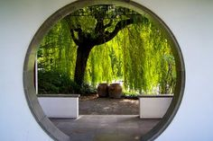 Ohhh, I want this garden gate and the weeping willow along with the clay pots and water feature