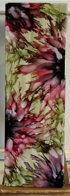 Spritzed Flowers in alcohol ink on 12x4 ceramic tile by Tina. Love the new pebble color for background.  Pesto for green and black, cranberry and pink for flowers.