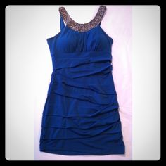 Teal beaded dress Teal dress. Worn once for event. Stretchy,spandex material. In great condition. City Triangles Dresses