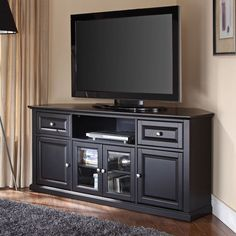 "Features:  -Beautiful raised panel and tempered beveled glass doors.  -Adjustable shelves.  -Finished back.  TV Size Accommodated: -60"".  Product Type: -TV Stand.  Design: -Corner unit.  Frame Materia"