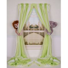 curtain tie backs, great use for stuffed animals that never get used anyways! like the mural too!