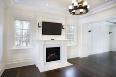 Step Out of the and Refresh That Dated Wood Veneer!: Elegant living room with painted paneling Cover Wood Paneling, Painting Wood Paneling, White Paneling, Paneling Ideas, Paneling Walls, Wall Panelling, Judges Paneling, Vinyl Panels, Beadboard Wainscoting