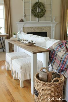 I like this look for behind the couch - extra blankets in the basket?
