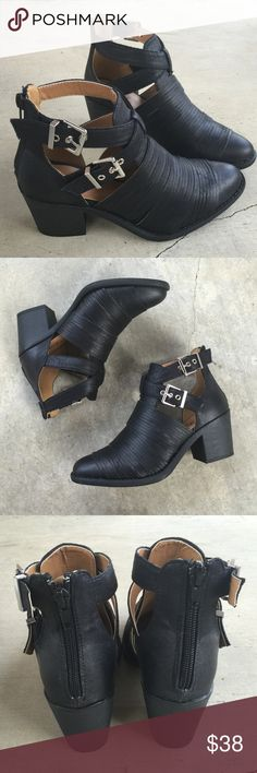 "Black slashed buckle crisscross straps ankle boots Buckle into these beauties. These booties are the ideal booties for any season. We love it paired with a distressed denim and heavy outerwear.  Material: Man-made, leatherette Sole: Synthetic  Measurement: Heel Height: 2.5""  Fitting: True to size Shoes Ankle Boots & Booties"