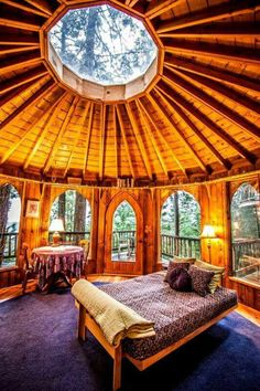 Wooden dome room with skylight