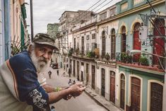 Cuban man on a balcony in Central Havana, Cuba