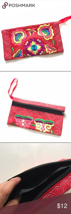 """🔥BOGO🔥 New Red Handmade Embroidered Wristlet New Red Handmade Embroidered Wristlet measures 4.5"""" x 8.5"""" with black 2 pocket lining and front zipper closure.   Bag is handmade but machine embroidered and brand new from manufacturer.  Bag color is consistent, design and embroidered colors may vary slightly from pictures shown.  Perfect for night out or day Purse or a makeup bag or pencil case.  Multiple colors listed. Great gift idea! Handmade Bags Clutches & Wristlets"""