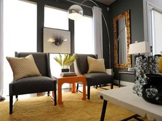 As seen in this virtual tour, the living room at HGTV's 2011 Green Home blends sleek contemporary furnishings with an urban loft-style design that captures plenty of sunlight and an open, outdoor feel.
