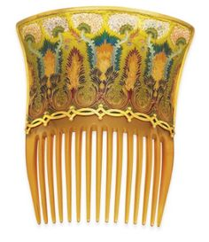 art nouveau tortoiseshell hair combs with plique-à-jour enamel flowers and foliate scrolling detail by Braquemond. There is scalloped 18K gold trim, and it is mounted in enamel. c.1900