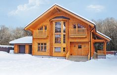 Modern Wooden house from Finland – model Scandinavia with garage provideod by Rovaniemi Log House (www.loghouse.fi )