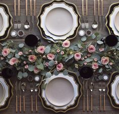 Eucalyptus and rose centerpiece with dark accents