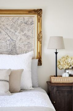 ticking strip sheets with gold framed paris map... so calming