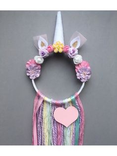 Make your little girls dreams come true, whilst catching the bad ones, with this one of a kind Unicorn Dream Catcher. This item will certainly add a magical touch to your little ones bedroom. Measurements: 6inch hoop/25-30cm tassel length. These are unique made to order items and can be personalised to perfectly colour match your little girls bedroom - just pop a note with any requests you may have in the customisation box.