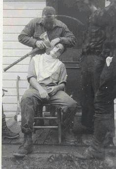 First shave in a logging camp