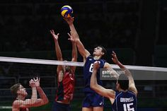 Simone Giannelli of Italy stretches for the ball during the Men's Volleyball Semifinal match on Day 14 of the Rio 2016 Olympic Games at the Maracanazinho on August 19, 2016 in Rio de Janeiro, Brazil.