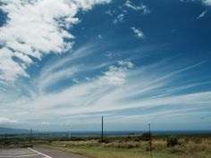 The blue skies and the streaky clouds are so cool in this photo! #Hawaii | Photography by Joseph Macomber