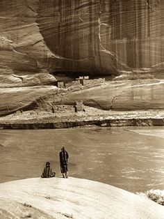 """""""Alone with the past."""" Two Diné (Navajo) view the ruins of Casa Blanca in Canyon de Chelly. Arizona. 1913. Photo by Roland W. Reed. (Original)"""