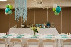 Chiffon fabric chandelier and netting on the ceiling. Under the Sea Mermaid Girl Ocean 3rd Birthday Party Planning Ideas