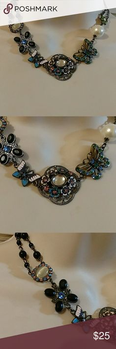 Betsey Johnson Floral Butterfly Statement Necklace Betsey Johnson gunmetal silver tone floral butterfly statement necklace. 17 and 1/2 inches long end to end. The center piece of the necklace is 1 and 1/2 inches across and 1 and 1/4 inches high. New without the tags. Betsey Johnson Jewelry Necklaces