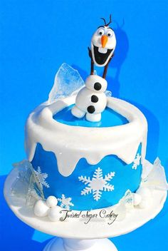 "Olaf, from the movie ""Frozen""   There is also sparkly snow that doesn't really show in the pic.  Ice is made of sugar."