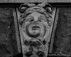 Shot in black and white, detail on an sculpture representing a female figure placed on the facade of this historic building, set in Stockholm, Sweden, Europa, Europe
